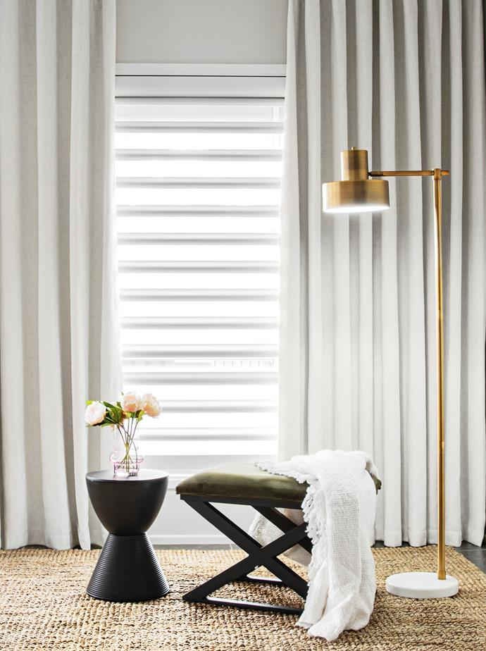 Pairing the fabric vanes of Luxaflex Window Fashions' Pirouette shades with a floor-length curtain adds texture to a room.