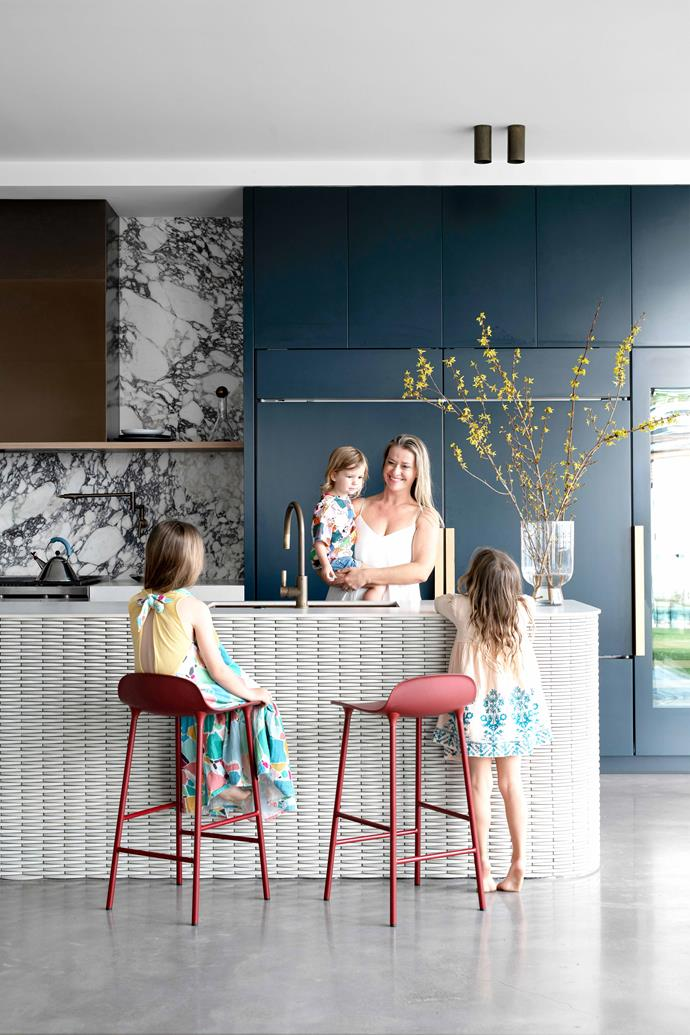 """The eye-catching element in the space is the heavily veined Viola marble on the splashback, while the paint colour is a custom navy similar to Porter's Paints Squid Ink. Taps, [Brodware](https://www.brodware.com/