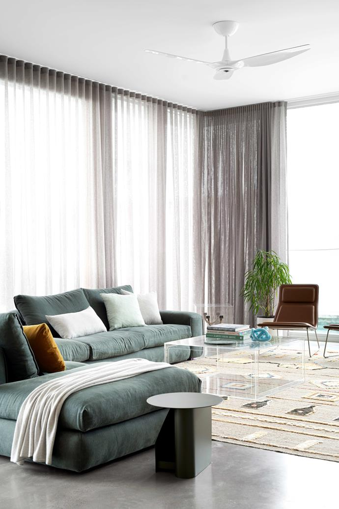 """Lofty 3.3m ceilings allow the light to pour in. The sofa and rug are from [Jardan](https://www.jardan.com.au/pages/sydney-store