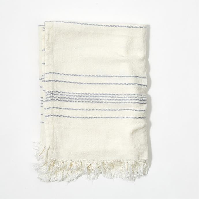"""**[Stripe Throw in Grey](https://myhouse.com.au/collections/home-beautiful/products/home-beautiful-stripe-throw-grey target=""""_blank"""" rel=""""nofollow""""), 130cm x 150cm, $99.99**  Woven in a beautiful linen blend, this throw is luxuriously soft and has a natural textured finish. Subtle grey stripes on a creamy white base complement the raw fringe edges and achieve a relaxed, sophisticated look."""