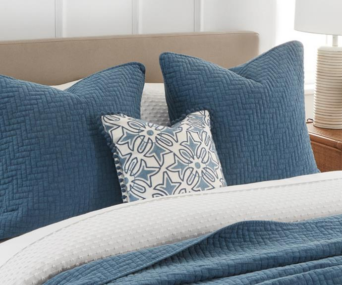 """**[Vista Cushion](https://myhouse.com.au/collections/home-beautiful/products/home-beautiful-vista-cushion target=""""_blank"""" rel=""""nofollow""""), 45cm x45cm, $49.99**  The Vista cushion features a detailed embroidery design in tonal blues and a charming small pom pom trim."""