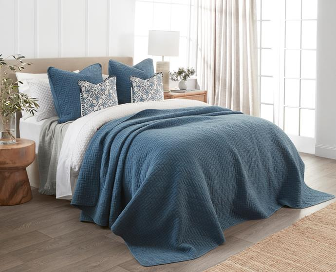 """**[Naya Coverlet in Blue](https://myhouse.com.au/collections/home-beautiful/products/home-beautiful-naya-coverlet-queen-king-blue target=""""_blank"""" rel=""""nofollow""""), queen/king, 250cm x 240cm, $199.99**  Perfect for a lightweight layer in summer, or layer in for added warmth in winter, the Naya Coverlet in blue will bring a beach holiday aesthetic to your bedroom."""