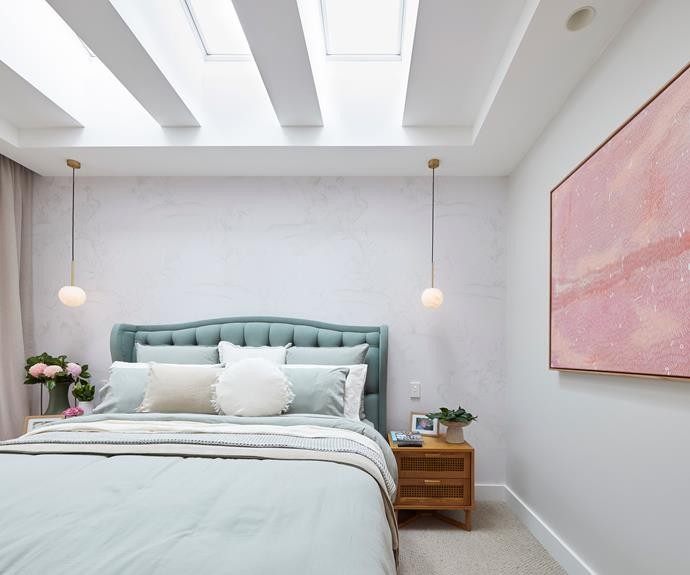 """Neale loved the simple elegance of the bedlinen colours and styling. """"They can come and give *me* lessons on how to make a bed. That's beautifully done."""" Pendant lights from [Beacon Lighting.](https://www.beaconlighting.com.au/made-by-mayfair-lucent-100mm-pendant-in-brass-alabaster