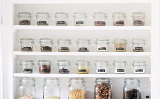 Spices stored in labelled Mason jars on a pantry shelf