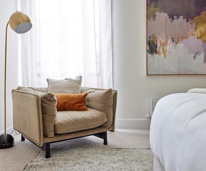 """Ronnie and Georgia created a calming, luxurious master bedroom. Armchair from [Trit](https://www.trithouse.com.au/brands/wendelbo/kite-lounge-chair
