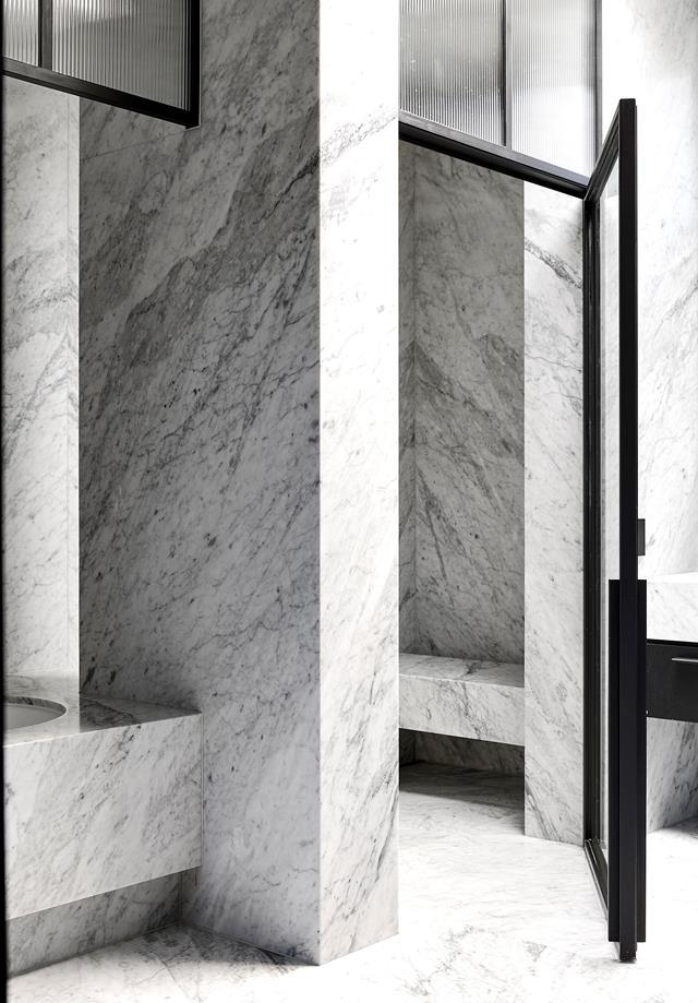 """Although contemporary, this ensuite boasts timeless appeal with its monochrome palette and Carrara marble from Peraway Marble. It's perfectly fitting for the [heritage-meets-modern home](https://www.homestolove.com.au/victorian-villa-restoration-22891/