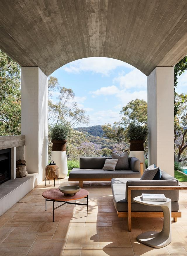 """Elevated above the back garden and combined with a new sandstone terrace, this [Mediterranean-style home's](https://www.homestolove.com.au/1950s-home-mediterranean-style-makeover-22097/ target=""""_blank"""") outdoor-indoor space, with its built-in fireplace, is used all year round."""