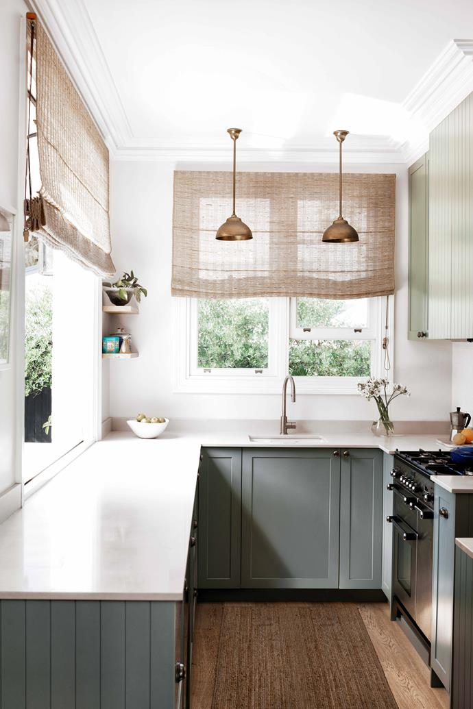 """The kitchen is a serious cook's space, updated with [Smartstone](https://www.smartstone.com.au/ target=""""_blank"""" rel=""""nofollow"""") Carrara benchtops and Shaker-style cabinetry in Moorhen by [Porter's Paints](https://www.porterspaints.com/ target=""""_blank"""" rel=""""nofollow""""). A Falcon five-burner stove from Harvey Norman, a [Vintec wine cabinet](https://www.vintec.com/en-au/ target=""""_blank"""" rel=""""nofollow"""") and Smartstone Carrara benchtops built to 990ml for the comfort of the owners, both more than six foot tall. Taps, [Brodware](https://www.brodware.com/ target=""""_blank"""" rel=""""nofollow""""). Pendants, [Pearl Lighting & Brassware](https://www.pearllighting.com.au/ target=""""_blank"""" rel=""""nofollow"""")"""