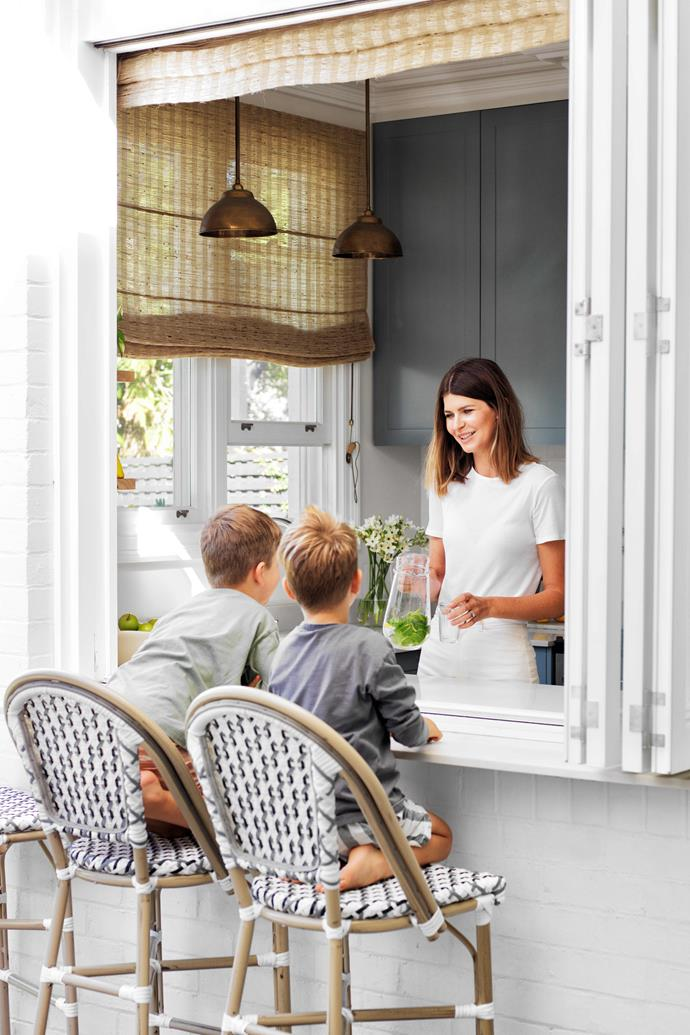 """Annika isn't a fan of open-plan design but her concession to today's indoor/outdoor flow is the bifold-bordered servery, where Archer and Henry sit. Find similar stools at [Alfresco Emporium](https://alfrescoemporium.com.au/ target=""""_blank"""" rel=""""nofollow"""")."""
