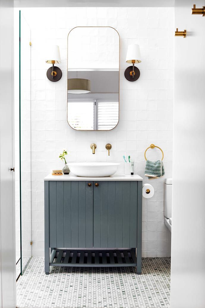 """This newly created space features a Victoria & Albert basin from [Cass Brothers](https://www.cassbrothers.com.au/ target=""""_blank"""" rel=""""nofollow"""") and sconces from [West Elm](https://www.westelm.com.au/lighting target=""""_blank"""" rel=""""nofollow"""") flanking a [Reece](https://www.reece.com.au/search/vanities-mirrors-c621/mirrors-cabinets-c623/mirrors-c689/?pageNumber=1 target=""""_blank"""" rel=""""nofollow"""") mirror. Wall and mosaic floor tiles, [Di Lorenzo](https://dilorenzo.com.au/ target=""""_blank"""" rel=""""nofollow"""")."""