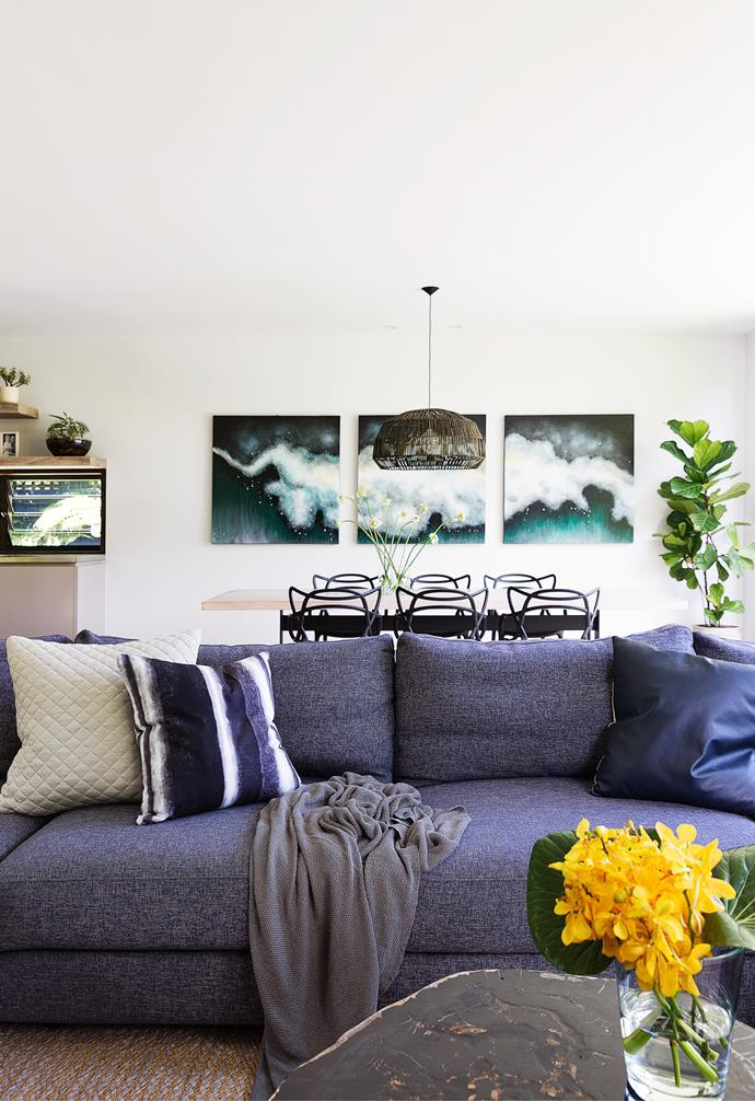 """""""We wanted a light-filled, relaxed and connected living space where everyone could talk to each other,"""" explains Pippa of the large open-plan living area. The 'Concerto' sofa from King Living got the thumbs up for its generous proportions and comfort factor, boosted by Shibori cushions and a linen throw in Indigo sourced from Maison Et Jardin. Natural texture comes courtesy of the Ascraft 'Grasscloth' wallpaper behind the television and an Armadillo & Co 'Kalahari' rug."""