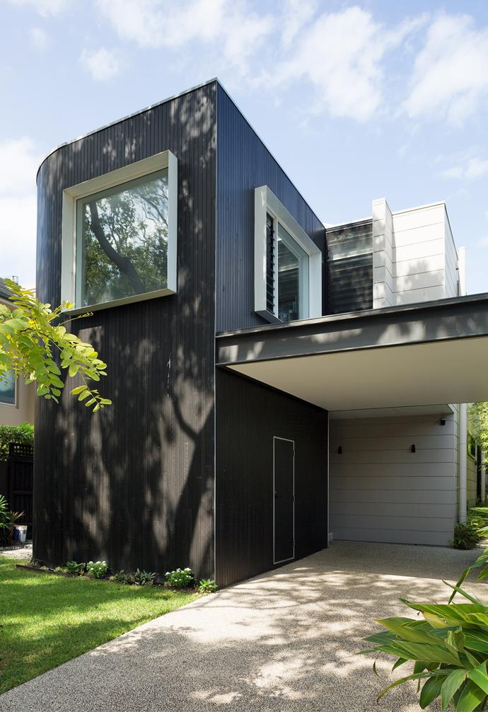 """""""While we designed the curved facade as a nod to the curves on the building next door, it also made sense to round off the edges to soften the expanse of dark timber cladding,"""" says architect Ramon. """"Doing work like this on a prefabricated home gave us a wonderful opportunity to customise and create something unique."""" The mix of exterior paint on the weatherboards, window frames and [timber cladding](https://www.homestolove.com.au/perfect-the-scandi-style-with-timber-panelling-3847