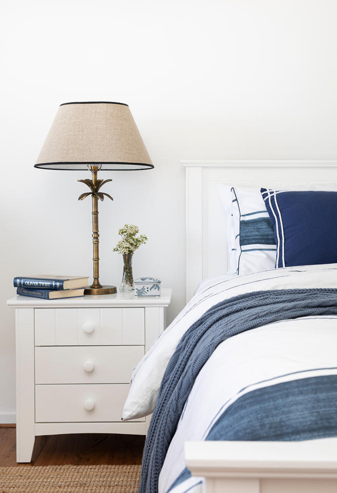 """Classic bedlinen by Pillow Talk and a 'Noah' bedside table and lamp from One World Noosa are a relaxed and comfortable choice in the bedroom of this transformed [beach house on the Sunshine Coast](https://www.homestolove.com.au/transformed-beach-house-sunshine-coast-22249