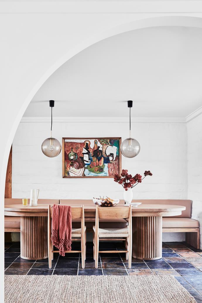 """**Dining Room:** The arch feature was inspired by [Mediterranean architecture](https://www.homestolove.com.au/modern-mediterranean-style-4700