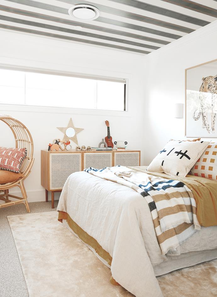 Bedlinen, I Love Linen. Throw, Pony Rider. Cushions, Bonnie and Neil. Rattan sideboard, Lounge Lovers. Rattan chair, Hunter and Nomad. Wallpaper on ceiling, The Society Inc. Rug, BoConcept. Artwork, Olive et Oriel.