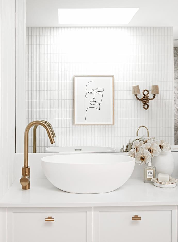 Above middle Artwork, Lounge Lovers. Custom vanity, Carrera by Design. Caesarstone Pure White benchtop. Basin and tapware, Reece. Kit Kat wall tiles, TileCloud. Russes wall light, The Society Inc.