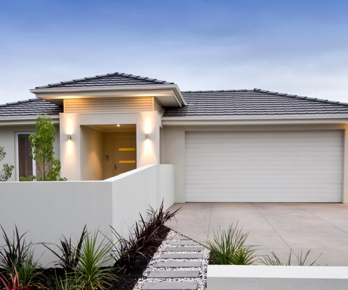 Repainting a tired garage door will improve the look of your home's exterior.