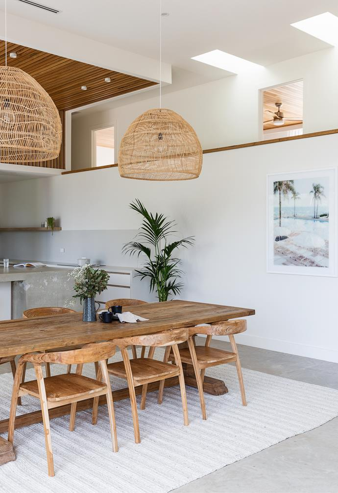 """The 'Hanging Ball Lamps' in Natural Wicker from House Of Orange help to fill the spacious open-plan area and balance the polished concrete floors in this [Palm Springs-inspired new build](https://www.homestolove.com.au/palm-springs-new-build-sydney-22838