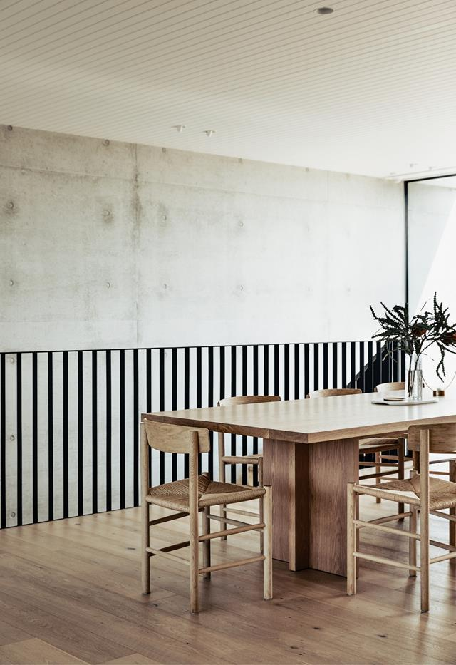 """A beautiful timber Christopher Blank dining table takes pride of place in the open plan kitchen, dining and living space of this [Mornington Peninsula abode](https://www.homestolove.com.au/contemporary-coastal-home-victoria-22859