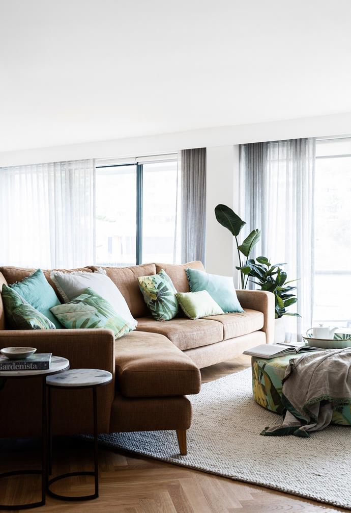 """Nicole's favourite part of the renovation is this open-plan space, where caramel tones in the Havwoods 'Pallido' herringbone oak floor find resonance in a 'Hayman II' sofa, custom-designed by [Your Beautiful Home](https://yourbeautifulhome.com.au/
