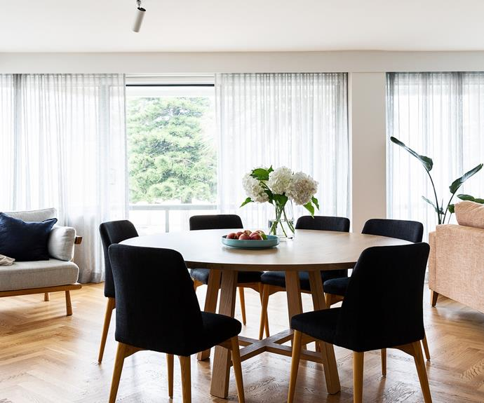 """A'Balmoral'American oak table from Loughlin Furniture was one of Nicole's renovation """"non-negotiables"""" and is surrounded by 'Rosie' dining chairs in Soot from Globe West. She included """"a chair by the window"""" in her brief, and sipping tea or reading in the Home Republic 'Copenhagen' armchair from Adairs is a delight."""