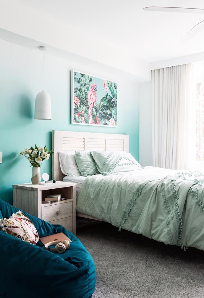 """Starring an ombre-effect wall that was Charlotte's idea, her bedroom is simultaneously serene and uplifting. An 'Ocean Grove' bed and bedhead from Snooze contrasts with 'Claude' wallpaper in Ombre Teal from Emily Ziz, while Rebecca Judd Loves linen from Adairs softens the scheme. A 'Mara' velvet lounge chair from Matt Blatt is a versatile addition, and a vivid artwork from Adairs draws the eye. All in all, """"Charlotte had a lot of input"""", remarks her mum."""