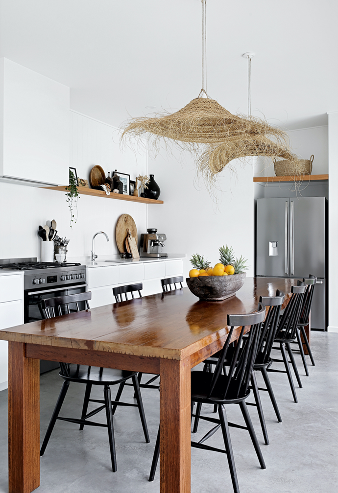 """The vast kitchen dining table in this [Cape Cod-inspired home on the Sunshine Coast](https://www.homestolove.com.au/renovated-beach-house-sunshine-coast-22148