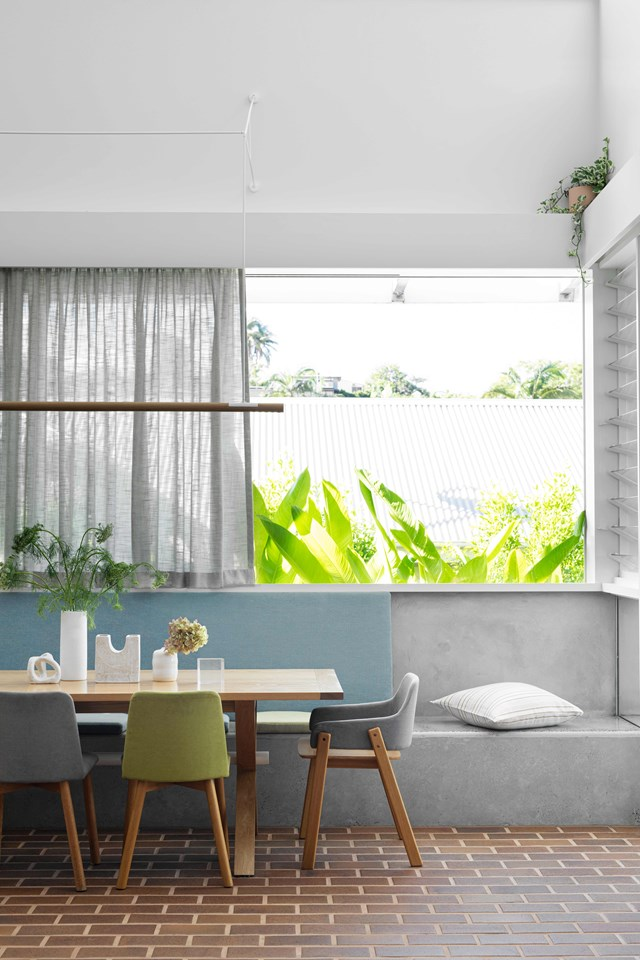 """Against a base of hand-laid bricks and smooth concrete finishes, artisan furniture, handmade ceramics and custom upholstery combine for a wholesome interior in [this renovated Queenslander](https://www.homestolove.com.au/queenslander-double-height-renovation-22963