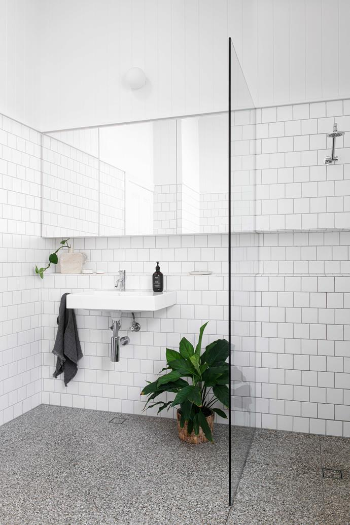 """White tiles laid in a stretcher bond pattern keep the look clean. Basin, [Caroma](https://www.caroma.com.au/