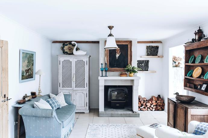 """Athol prefers white walls and a """"simple, plain, pulled-back"""" aesthetic. A portrait he's named The Guv'nor holds court over the sitting room."""