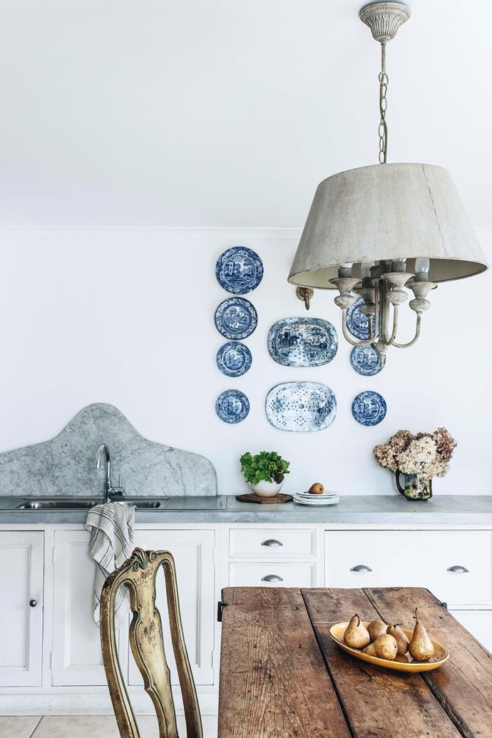 """The solid timber kitchen was bought at a [local garage sale](https://www.homestolove.com.au/valuable-garage-sale-finds-20780