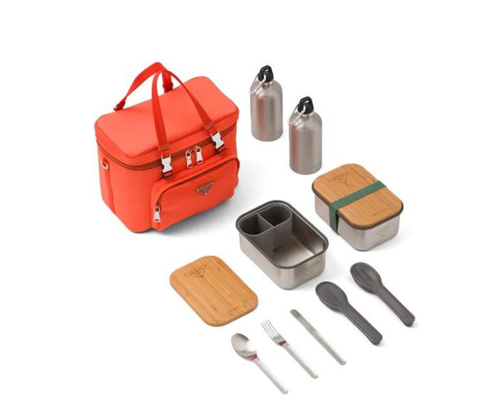 """**Orange nylon picnic bag, $4344*, [Prada](https://www.prada.com/us/en/men/prada_outdoor/products.nylon_picnic_bag.2UP012_074_F0049_V_OOO.html