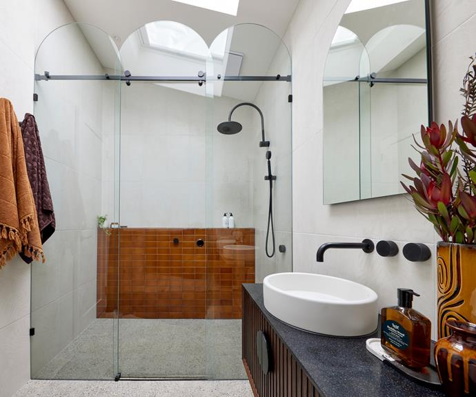 """Tanya matched the feature tiles in the shower to a vintage light fitting. Bath sheets and towels from [Aura](https://www.aurahome.com.au/paros-bath-sheet-caramel