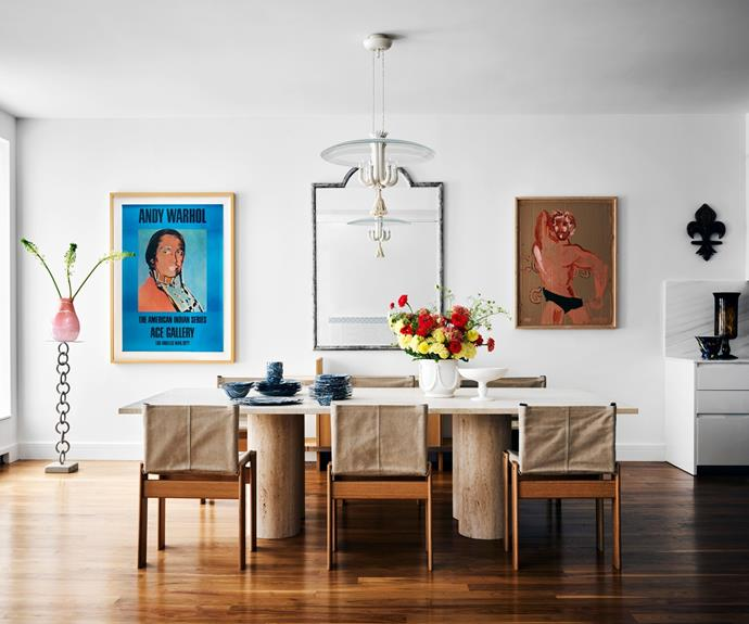 """The connected kitchen, dining and living rooms are perfect for entertaining and enhance the home's """"loft-like vibe"""". Of the [dining room](https://www.homestolove.com.au/relaxed-dining-area-ideas-3675 target=""""_blank"""" rel=""""nofollow""""), Jessica says, """"I used six Monk chairs by Afra and Tobia Scarpa for Molteni around a custom travertine table. I hung a delicate Pietro Chiesa glass chandelier over it to juxtapose the solid table."""" The '60s sideboard is by Angelo Mangiarotti for Poltronova. To the left of the mirror from 1stDibs is Andy Warhol's Russell Means; to the right is a Mattea Perrotta painting. The pink vase is by Paul Arnhold and the glazed ceramic tableware is from Casa Gusto."""