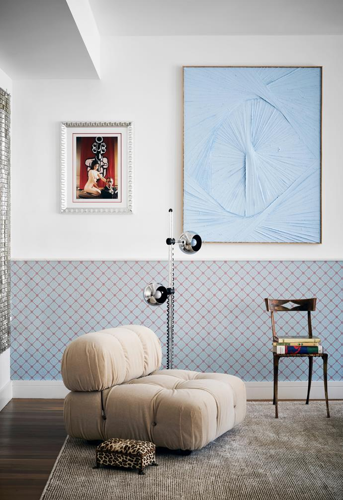 While Jessica didn't use much colour in her previous homes, she added blue accents to this apartment's neutral base. In this corner of the living room is A Satisfying Entry Into the Self by Matthew Chambers, a '70s Paco Rabanne 'Space Curtain' from 1stDibs and vintage Salvador Dali photograph. The Camaleonda seat is part of the modular sofa, which Jessica had reupholstered in Fisherman's Fabrics 'Dolce Alpaca' in Biscuit. The lamp is from 1stDibs; the chair and stool are both vintage. Adelphi Paper Hangings 'Strawberry Plaid Hill' wallpaper decorates the white walls.