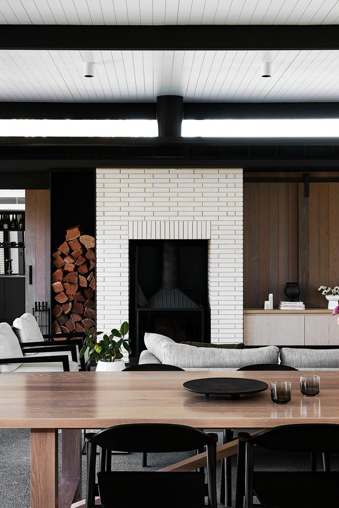 """**LIVING AREA** Though the polished concrete floors in the new section are hydronically heated, the cosy [Cheminees Philippe fireplace](https://chemphilaust.com.au/