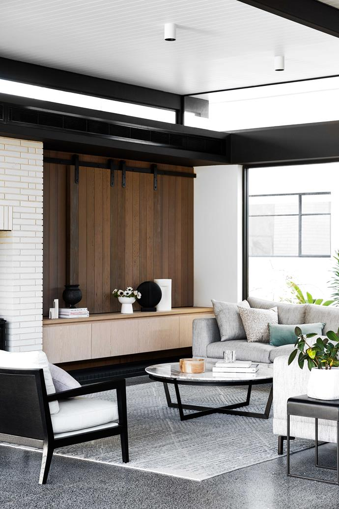 """**LIVING ZONE** The pavilion is fitted with oak-veneer joinery, cedar cladding and white-face linear bricks, while grey-stained cedar doors appear in both the old and new sections. Custom sofa, [Cosh Living](https://coshliving.com.au/