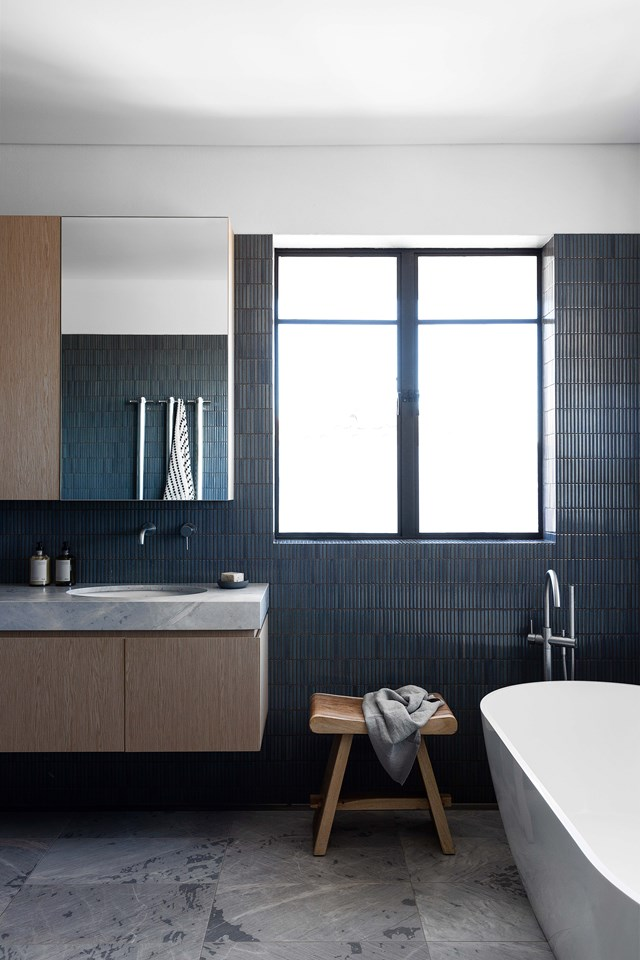 """Timber and tiles. Finger mosaics create the illusion of height and introduce welcome texture into the bathroom of [this renovated 1930s family home](https://www.homestolove.com.au/1930s-home-scandi-minimal-renovation-22978