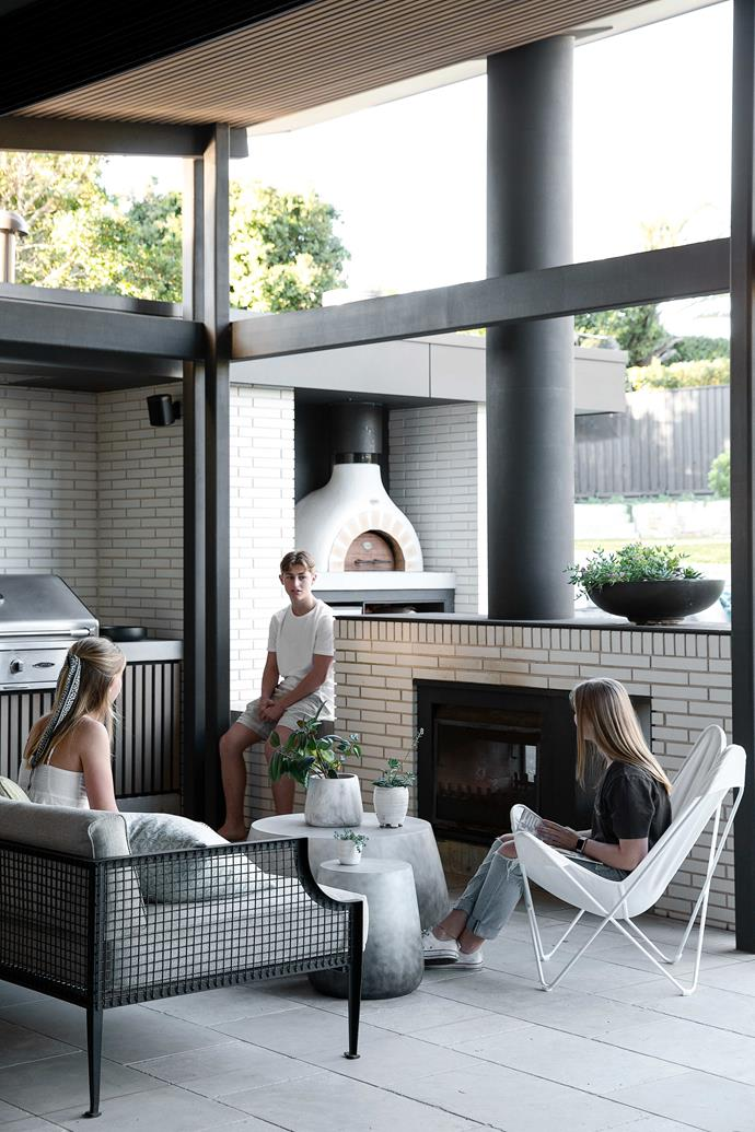 """Near the pool is an outdoor bar originally slated as a pool-equipment cupboard. Garonne Tumbled Limestone flooring from [Eco Outdoor](https://www.ecooutdoor.com.au/products/natural-stone-flooring/limestone/garonne-2/