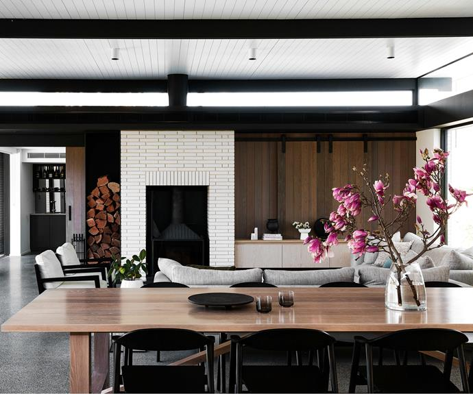 """**LIVING AREA** Owner Kathryn's favourite piece of furniture is the dining table. """"It was designed to fit the space by [FM Interiors](https://www.fminteriors.com.au/
