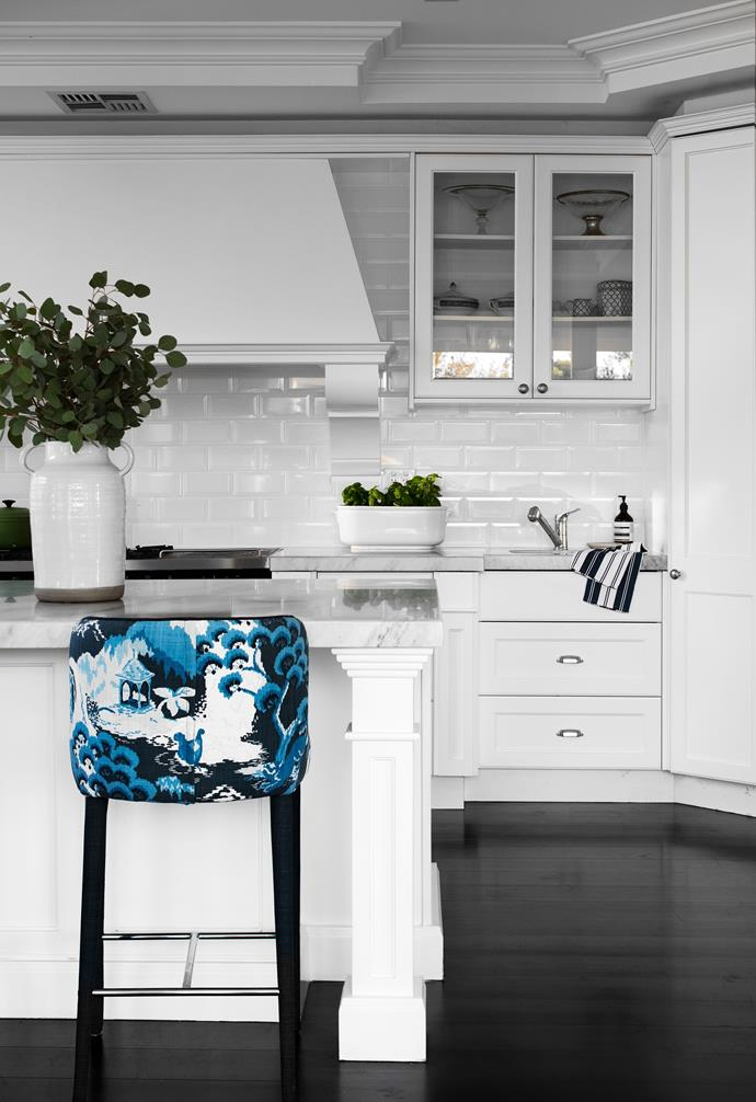 Kitchen stools are upholstered in Robert Allen Road to Canton fabric in Ocean.