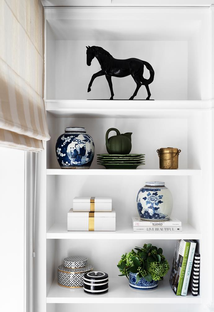 Sonja's treasures on display include a ceramic horse from Bed Bath N' Table.