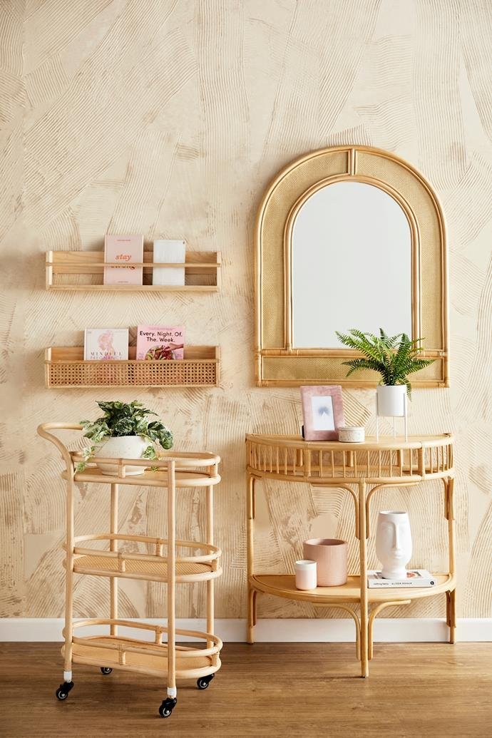 The rattan furniture collection includes a bar trolley, a hallway table, an arched mirror and assorted wall-mounted bookshelves.