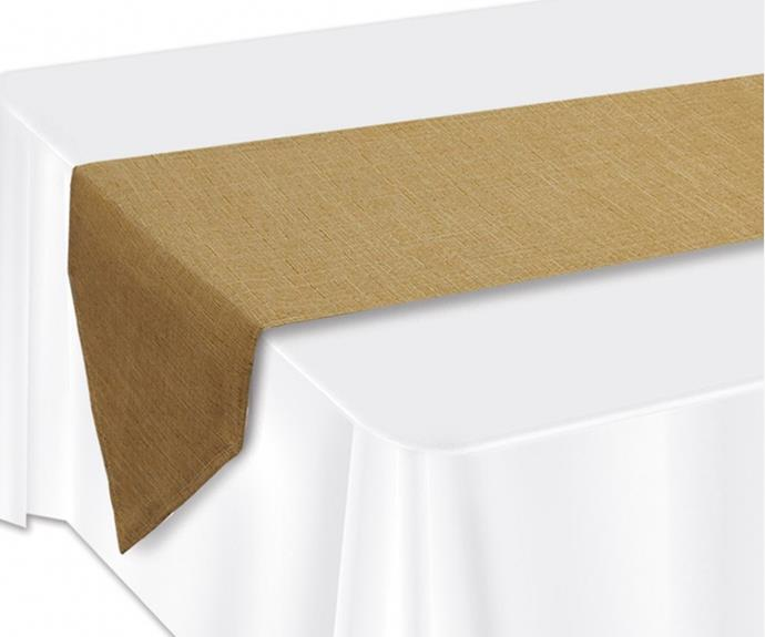 """Elevate even the simplest table setting with the [Faux burlap table runner, $16](https://www.bigw.com.au/product/faux-burlap-table-runner/p/856961/ target=""""_blank"""" rel=""""nofollow""""). Not only will it frame your feast, it will add a rustic, welcoming touch to the table."""