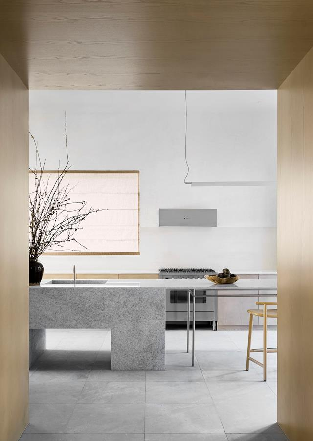 """The custom island in Blue Crystal marble, which imparts """"a shimmering quality"""", is the hero of this [coastal home's](https://www.homestolove.com.au/modernised-home-with-coastal-palette-21189 target=""""_blank"""") kitchen and creates interest in an otherwise minimal space. """"We wanted to explore the idea of a very solid and light approach to a stone structure that felt permanent – the block – and impermanent – the kitchen table that's pushed against it,"""" explains designer Anna Trefely of Esoteriko."""