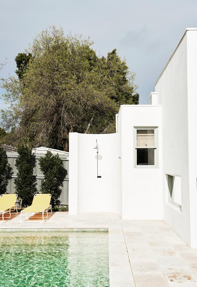 """Bright yellow sunlounges from Ikea add a retro touch to the pool area by Shoreline Pools. Lucy Bowen designed the outdoor shower, which features Brodware tapware. """"Our kids' friends love coming over, which makes us all happy,"""" Phoebe says."""