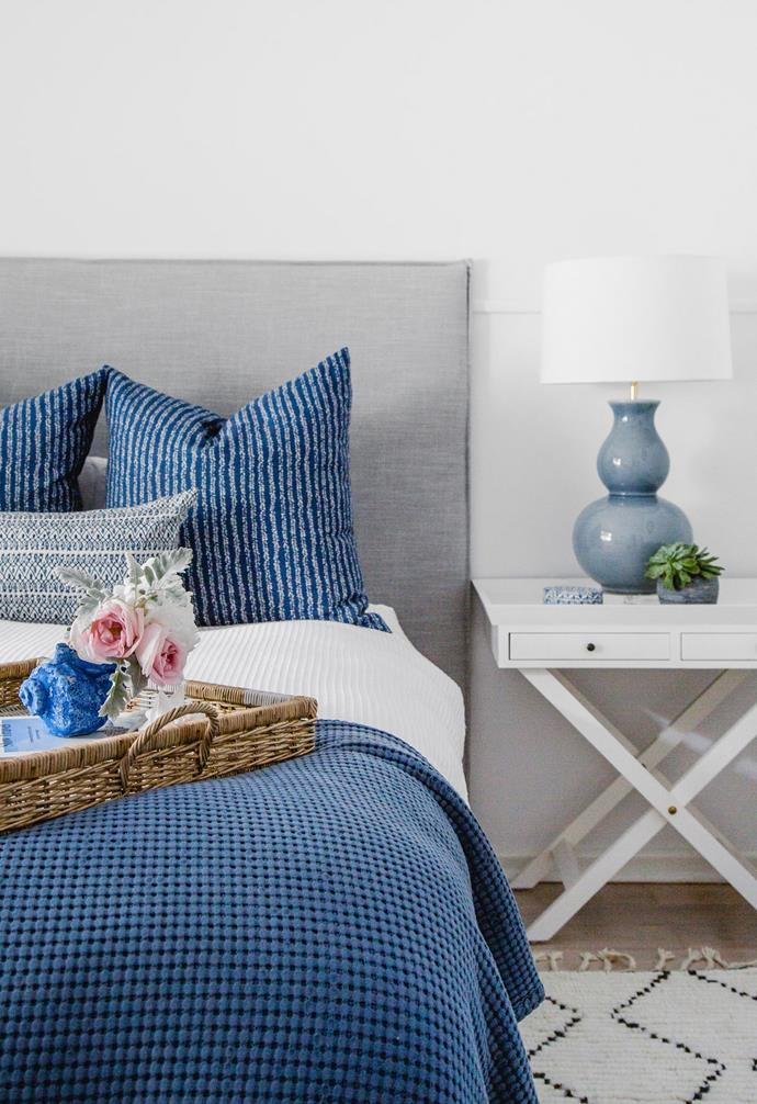The original home may have been calling for an intervention, but that's well in the past, thanks to its designer-owner's attention to detail. In Belinda and Dan's bedroom, the interior maven's colour crush on indigo is evident, with custom Walter G cushions, L&M Home bedlinen, a 'Jasmine' lamp from Bloomingdales and a vase by Iggy and Lou Lou from Pinky's. A bespoke upholstered bedhead from BQ Design and 'Brigitte' side table from La Maison lift the space.