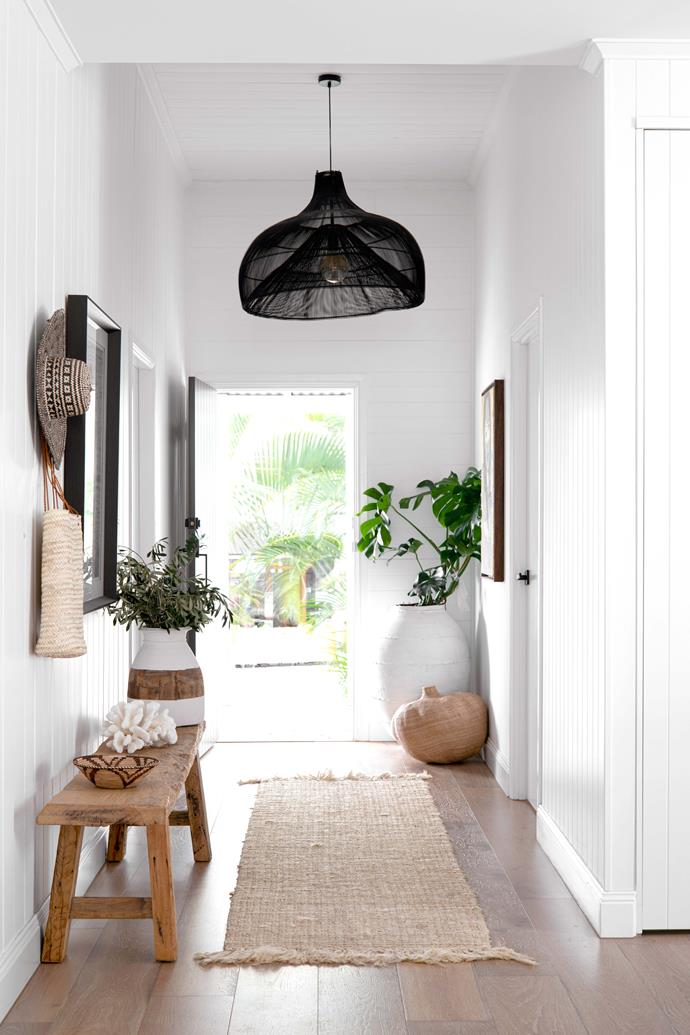 """**ENTRY** Dulux Lexicon Quarter continues into the home and its wide hallway, styled with a timber bench and pendant light from [St Barts](https://st-barts.com.au/