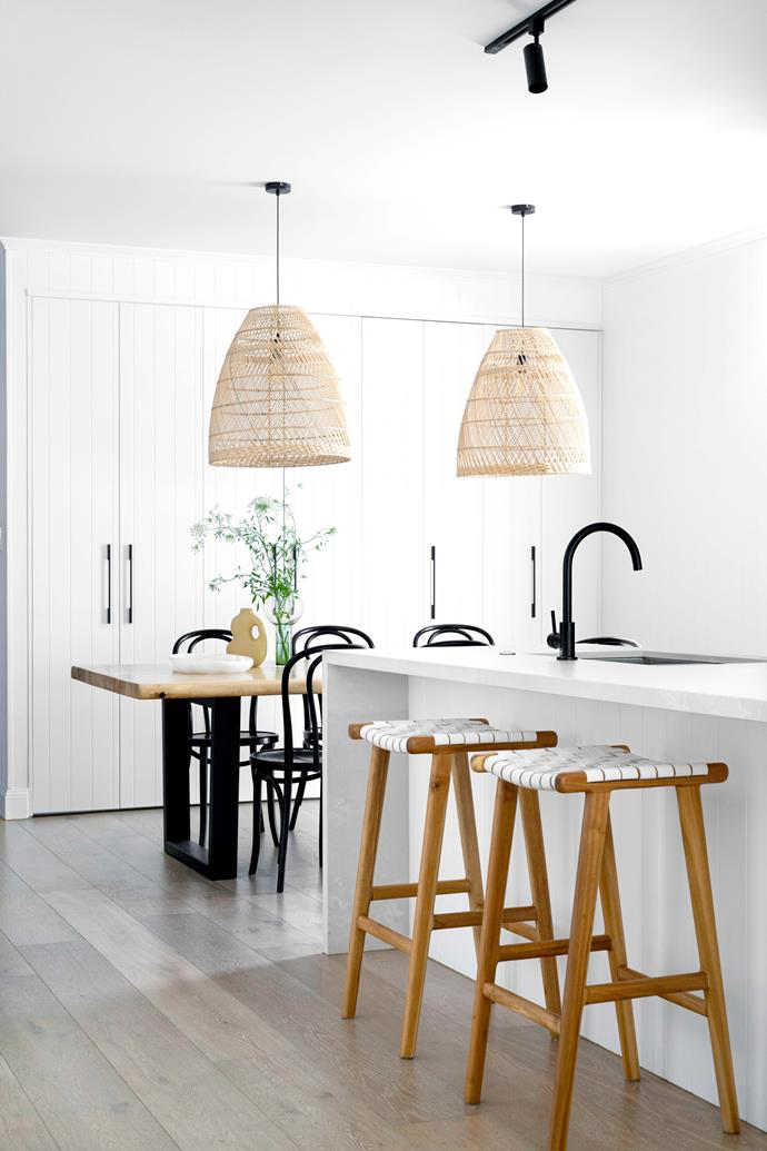 """**KITCHEN/DINING** While the living space is very open, there's a laundry and storage concealed behind its cabinet doors. Dining table, [GlobeWest](https://www.globewest.com.au/