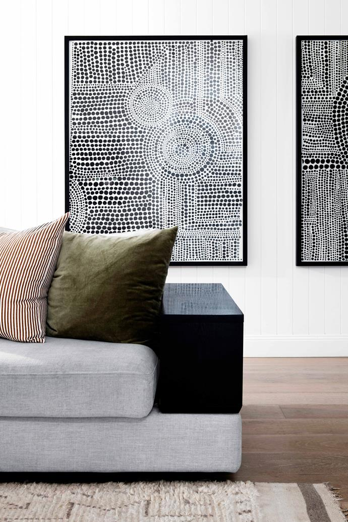 """Two artworks gifted to Jordan hang on the wall behind the sofa. Cushions, Clo Studios and [Città](https://www.cittadesign.com/